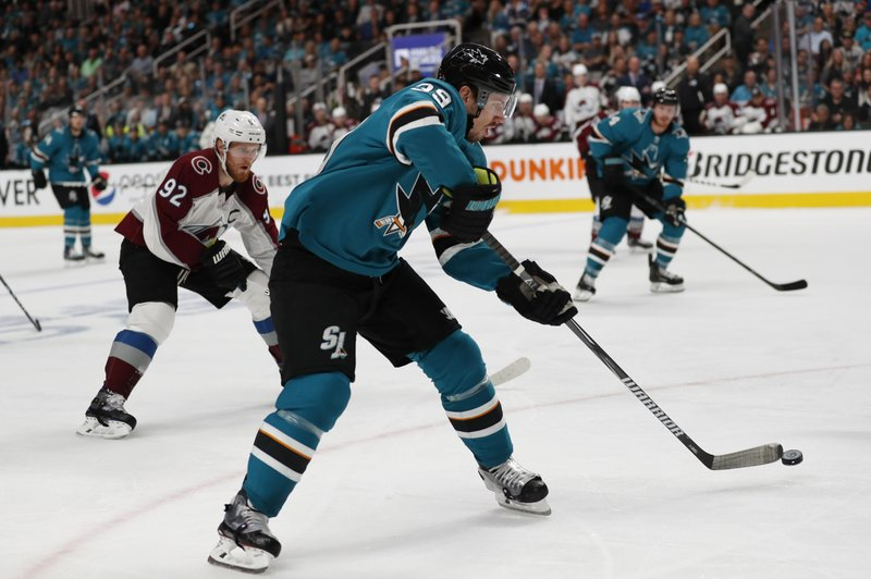 Colorado Avalanche's Gabriel Landeskog (92) chases the San Jose Sharks' Logan Couture (39), as he moves the puck downice in the first period of Game 2 of an NHL hockey second-round playoff series at the SAP Center in San Jose, Calif. (AP Photo/Josie Lepe)