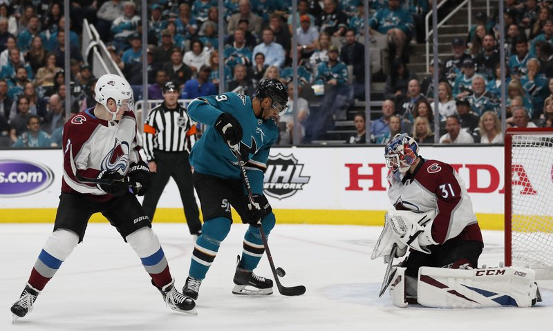 Colorado Avalanche's Cale Maker (8) watches as San Jose Sharks' Evander Kane (9) shoots to score against Colorado Avalanche goaltender Philipp Grubauer (31) in the first period of Game 2 of an NHL hockey second-round playoff series at the SAP Center in San Jose, Calif. (AP Photo/Josie Lepe)