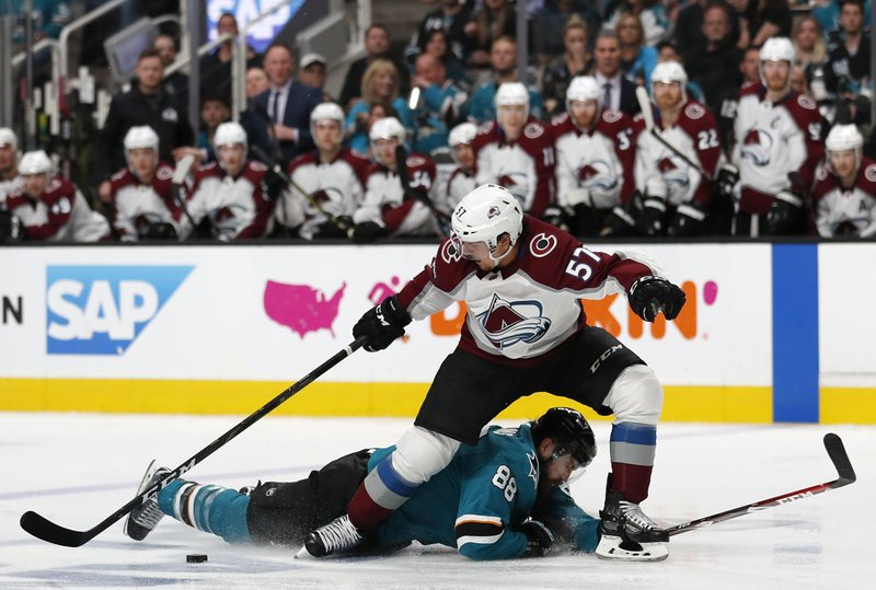 Colorado Avalanche's Gabriel Bourque (57) battles for the puck against San Jose Sharks' Brent Burns (88) in the second period of Game 2 of an NHL hockey second-round playoff series at the SAP Center in San Jose, Calif. (AP Photo/Josie Lepe)