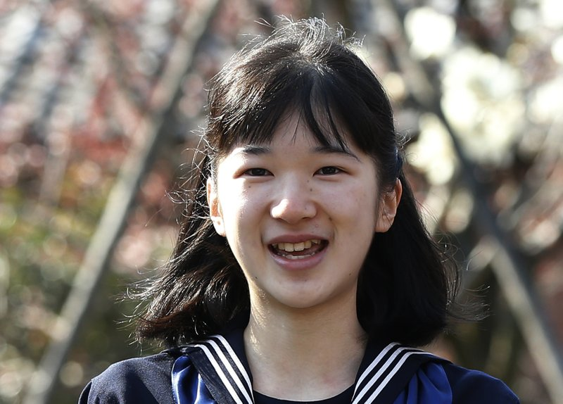 FILE - In this March 22, 2017, file photo, Japan's Princess Aiko, daughter of Crown Prince Naruhito and Crown Princess Masako, smiles as she attends her graduation ceremony at the Gakushuin Girls' Junior High School in Tokyo. (Issei Kato/Pool Photo via AP, File )