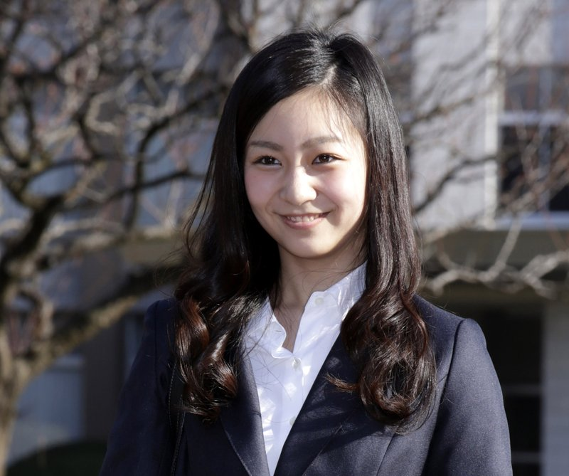 FILE - In this April 2, 2015, file photo, Japan's Princess Kako, younger daughter of Prince Akishino and Princess Kiko, poses on the campus of International Christian University prior to the entrance ceremony of the university in Tokyo. (AP Photo/Eugene Hoshiko, File)