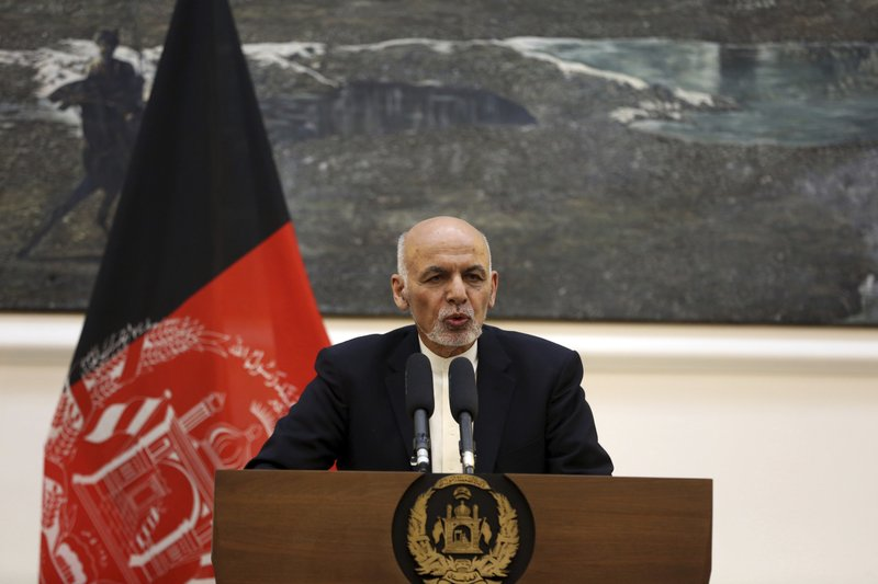 FILE - In this March 26, 2019 photo, Afghan President Ashraf Ghani speaks during a press conference with European Union foreign policy chief Federica Mogherini at the presidential palace in Kabul, Afghanistan. (AP Photo/Rahmat Gul, File)