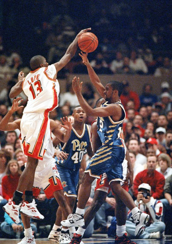 FILE - In this Jan. 22, 1995, file photo, St. John's freshman guard Felipe Lopez, left, tries to block a shot by Pittsburgh Panthers' Andre Aldridge, right, as Panthers forward Chris Gant (40) watches during the second half of their NCAA college basketball game, at New York's Madison Square Garden. (AP Photo/Kathy Willens, File)