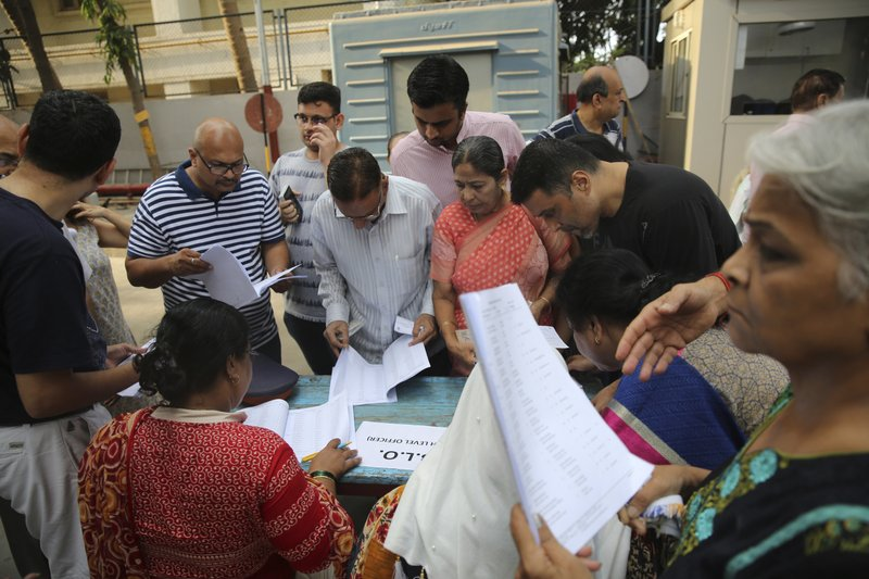 Indian voters try to find out their names in the voting list at a polling center during the fourth phase of general elections in Mumbai, India, Monday, April 29, 2019. (AP Photo/Rafiq Maqbool)