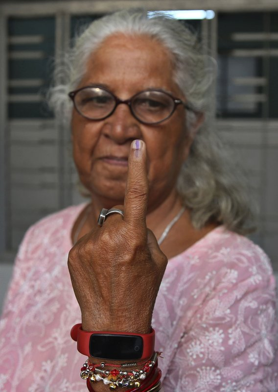 An elderly Indian shows the indelible ink mark on her index finger after casting vote during the fourth phase of general elections in Mumbai, India, Monday, April 29, 2019. (AP Photo/Rafiq Maqbool)