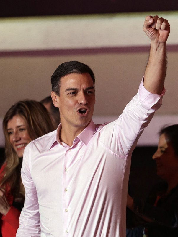 Spanish Prime Minister and Socialist Party candidate Pedro Sanchez gestures to supporters gathered at the party headquarters waiting for results of the general election in Madrid, Sunday, April 28, 2019. (AP Photo/Andrea Comas)