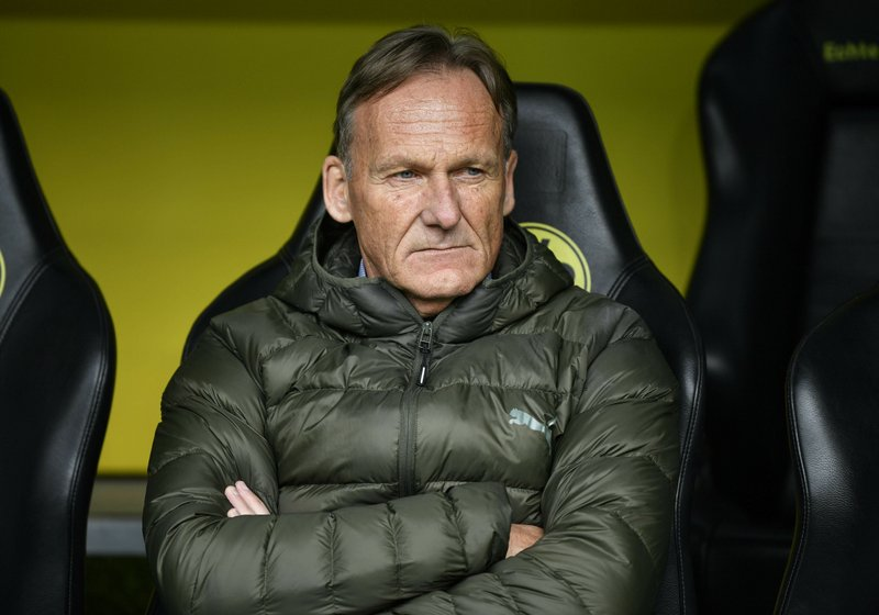Dortmund's CEO Hans-Joachim Watzke sits on the bench prior the German Bundesliga soccer match between Borussia Dortmund and FC Schalke 04 in Dortmund, Germany, Saturday, April 27, 2019. (AP Photo/Martin Meissner)