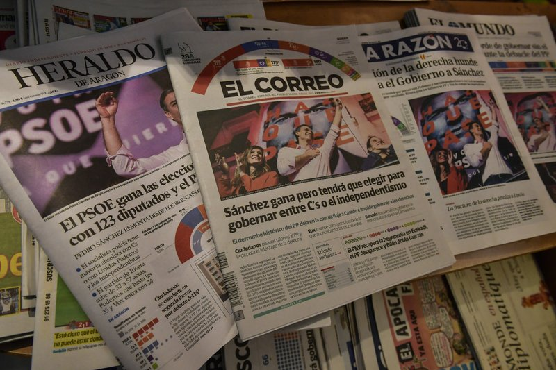 Spanish newspapers in Pamplona, northern Spain, announce the victory of Spain's Prime Minister and candidate of the Spanish Socialist Party, Pedro Sanchez, a day after general elections, Monday, April 29, 2019. (AP Photo/Alvaro Barrientos)
