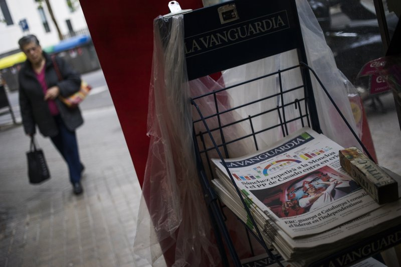 A newspaper carrying the front page of Spain's Prime Minister and Socialist Party leader Pedro Sanchez sit for sale at a newspaper stand in Barcelona, Spain, Monday, April 29, 2019. (AP Photo/Emilio Morenatti)