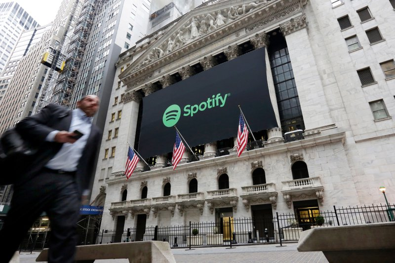 FILE - In this April 3, 2018 file photo, a Spotify banner adorns the facade of the New York Stock Exchange. (AP Photo/Richard Drew, File)