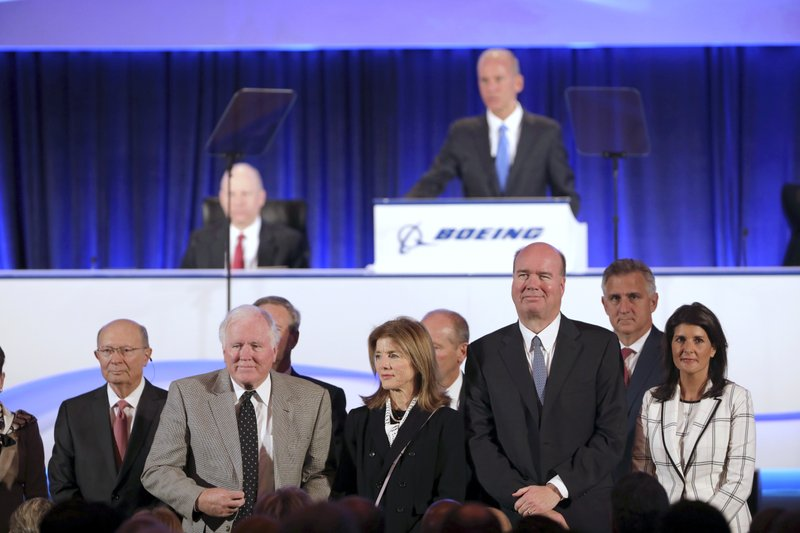 The Boeing board of directors including Nikki Haley, right, and Caroline Kennedy, third from right, are announced by Chief Executive Officer Dennis Muilenburg at the Boeing Annual General Meeting in Chicago, Monday, April 29, 2019. (John Gress/Pool Photo via AP)