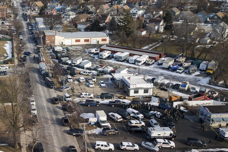 FILE - In this Feb. 15, 2019 file photo, law enforcement personnel gather near the scene of a shooting at an industrial park in Aurora, Ill. (Bev Horne//Daily Herald via AP, File)