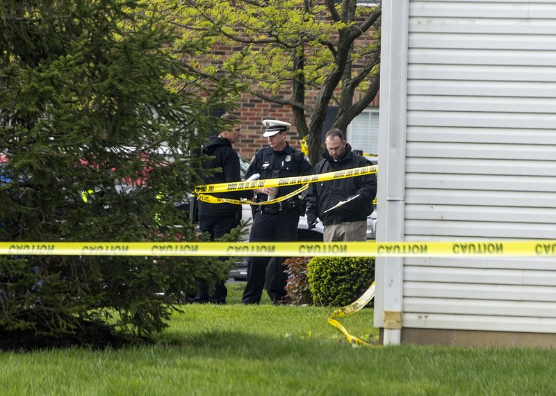 Police work the scene where multiple people were found dead Sunday night, at the Lakefront at West Chester apartment complex in West Chester Township, Ohio, Monday April 29, 2019. (Cara Owsley/The Cincinnati Enquirer via AP)