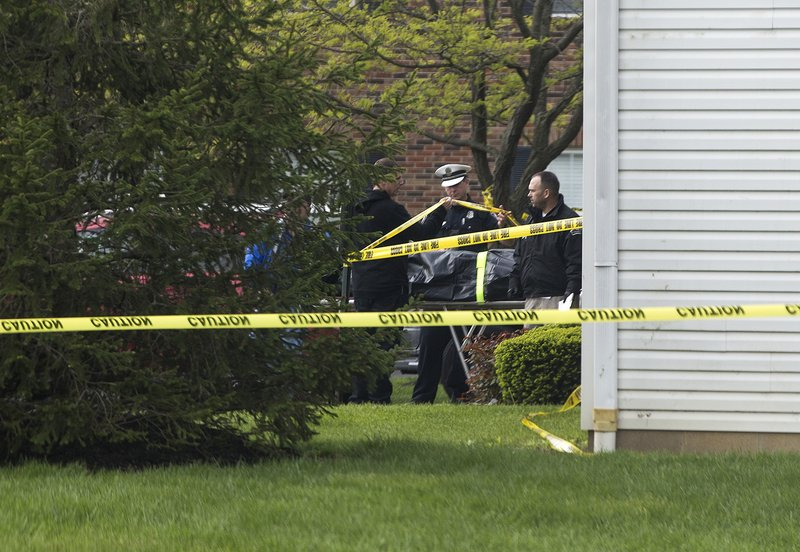 A body is loaded into a Butler County coroner's van Monday, April 29, 2019 after multiple people were found dead at the Lakefront at West Chester apartment complex in West Chester Township, Ohio on Sunday night, according to police. (Cara Owsley/The Cincinnati Enquirer via AP)