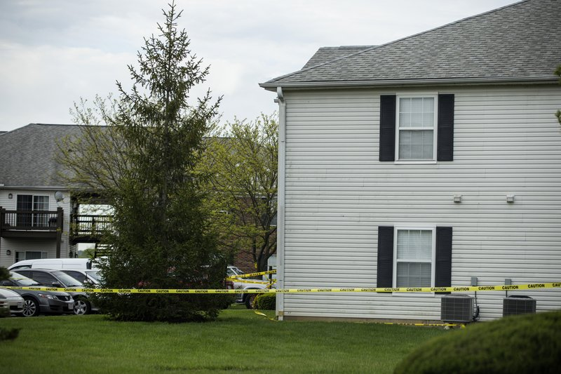 Police tape cordons off the scene where multiple people were found dead Sunday night, at the Lakefront at West Chester apartment complex in West Chester Township, Ohio, Monday April 29, 2019. (Cara Owsley/The Cincinnati Enquirer via AP)