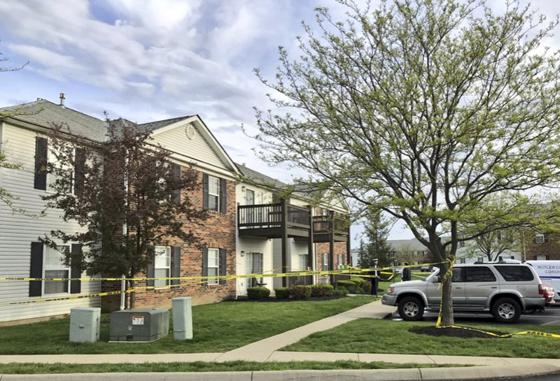 Police tape cordons off the scene where multiple people were found dead Sunday night, at the Lakefront at West Chester apartment complex in West Chester Township, Ohio, Monday April 29, 2019. (Keith Biery Golick/The Cincinnati Enquirer via AP)
