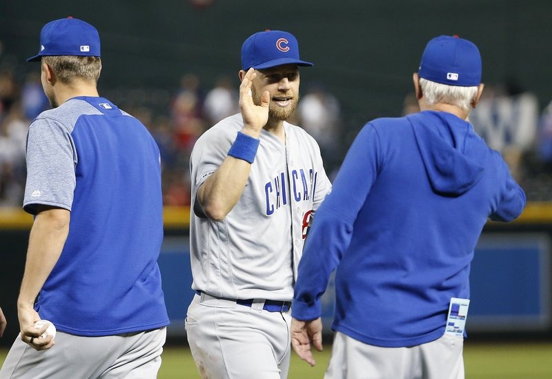 Chicago Cubs' Ben Zobrist, center, is congratulated by manager Joe Maddon, right, following a fifteen inning, 6-5 victory against Arizona Diamondbacks during a baseball game, Sunday, April 28, 2019, in Phoenix. (AP Photo/Ralph Freso)
