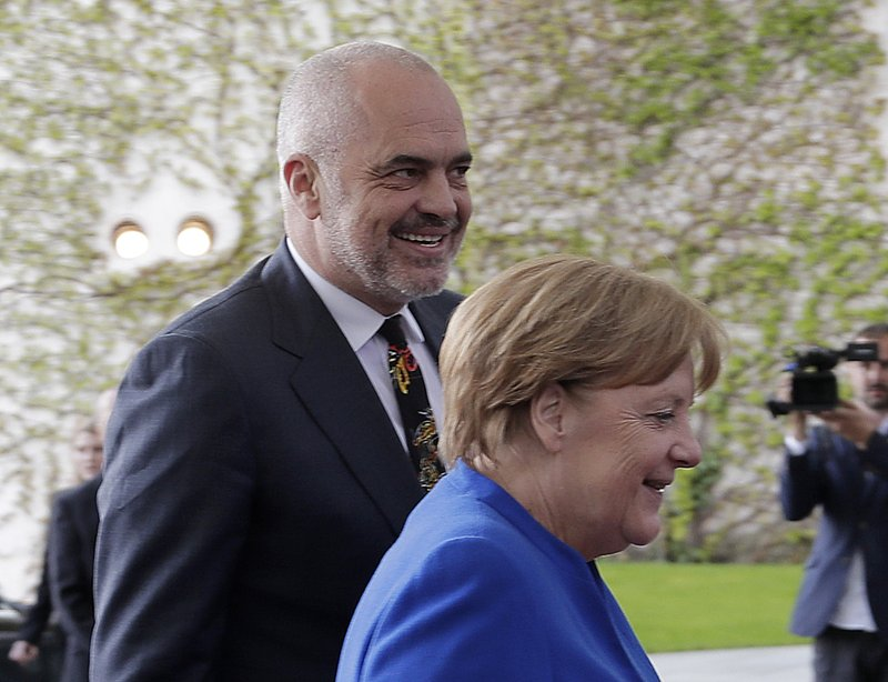 German Chancellor Angela Merkel welcomes Prime Minister of Albania Edi Rama for a meeting of Balkan leaders at the chancellery in Berlin, Monday, April 29, 2019. (AP Photo/Markus Schreiber)