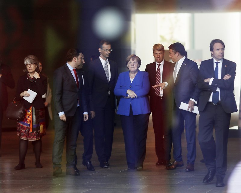 German Chancellor Angela Merkel, center, waits for a meeting of Balkan leaders at the chancellery in Berlin, Monday, April 29, 2019. (AP Photo/Markus Schreiber)