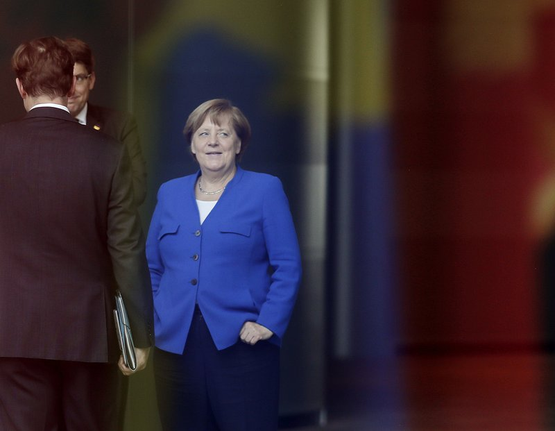 German Chancellor Angela Merkel waits for a meeting of Balkan leaders at the chancellery in Berlin, Monday, April 29, 2019. (AP Photo/Markus Schreiber)