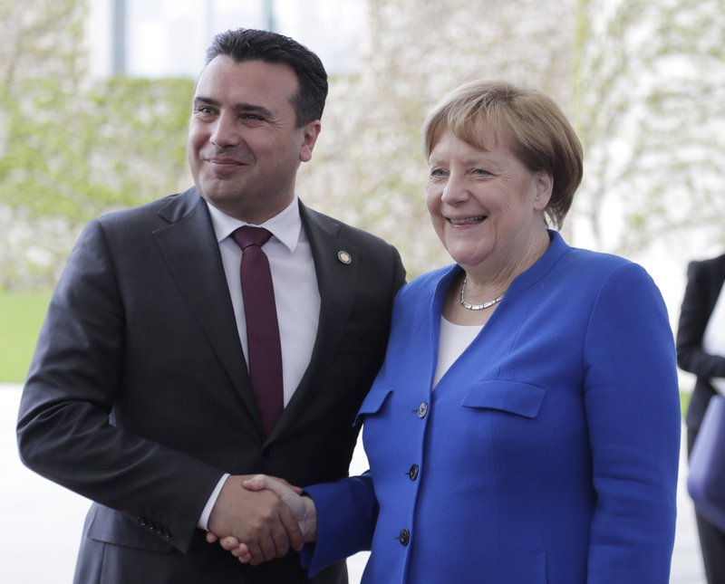 German Chancellor Angela Merkel welcomes North Macedonia Prime Minister Zoran for a meeting of Balkan leaders at the chancellery in Berlin, Monday, April 29, 2019. (AP Photo/Markus Schreiber)
