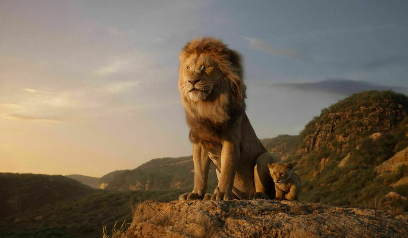 This image released by Disney shows the characters Mufasa, voiced by James Earl Jones, left, and Simba, voiced by JD McCrary, in a scene from