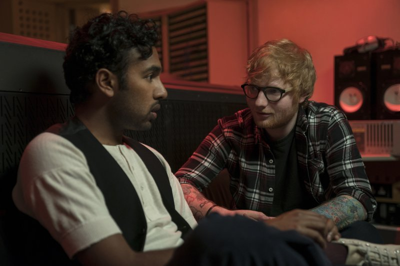This image released by Universal Pictures shows Himesh Patel, left, and Ed Sheeran in a scene from