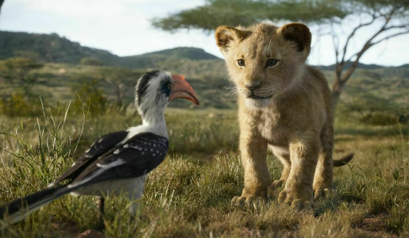 This image released by Disney shows the characters Zazu, voiced by John Oliver, left, and Simba, voiced by JD McCrary, in a scene from