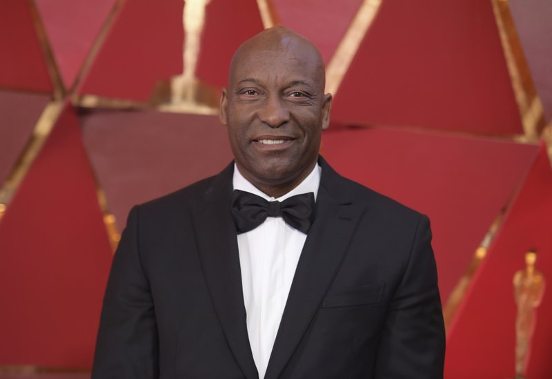 FILE - This March 4, 2018 file photo shows John Singleton at the Oscars in Los Angeles. The family for Singleton says the filmmaker will be taken off life support Monday, April 29, 2019, after suffering a stroke almost two weeks ago. (Photo by Richard Shotwell/Invision/AP, File)