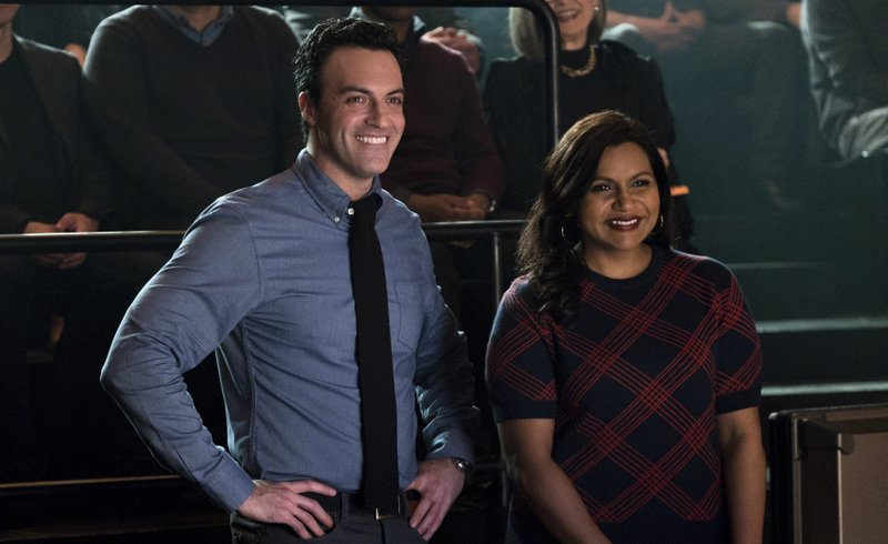 This image released by Amazon Studios shows Reid Scott, left, and Mindy Kaling in a scene from