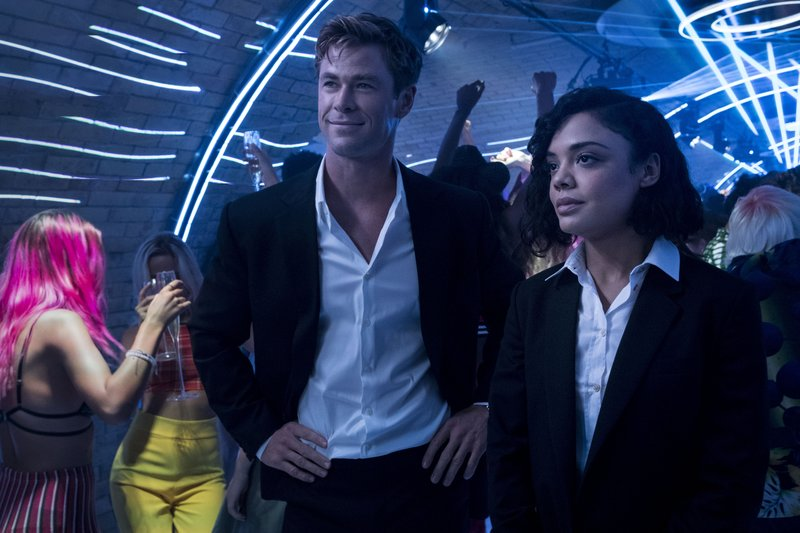 This image released by Sony Pictures shows Chris Hemsworth, left, and Tessa Thompson in a scene from Columbia Pictures'
