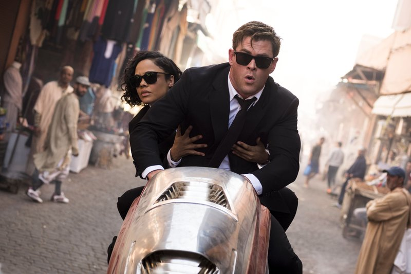 This image released by Sony Pictures shows Chris Hemsworth, foreground, and Tessa Thompson in a scene from Columbia Pictures'