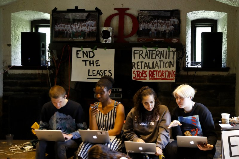 Swarthmore College students gather at the Phi Psi fraternity house during a sit-in, Monday, April 29, 2019, in Swarthmore, Pa. (AP Photo)