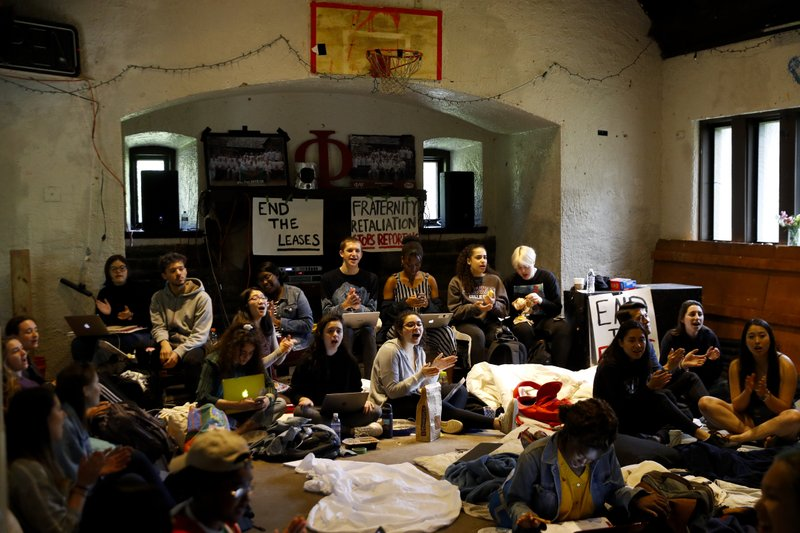 Swarthmore College students sing during a sit-in at the Phi Psi fraternity house, Monday, April 29, 2019, in Swarthmore, Pa. (AP Photo)