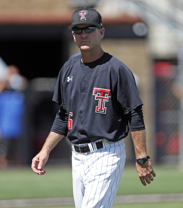 FILE - In this June 11, 2018, file photo, Texas Tech coach Tim Tadlock walks back to the dugout during an NCAA college baseball tournament super regional game against Duke, in Lubbock, Texas. (Brad Tollefson/Lubbock Avalanche-Journal via AP, File)