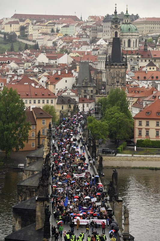 Thousands of people take part in a march in the centre of Prague, Monday April 29, 2019, to protest the proposed replacement of the justice minister. (Vit Simanek/CTK via AP)