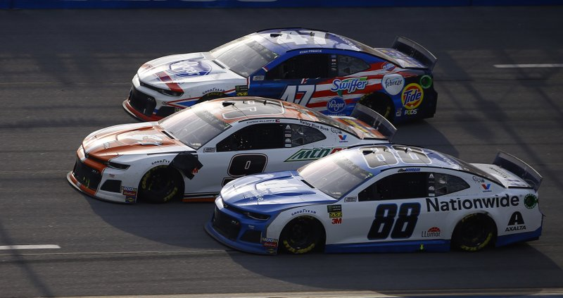 Chase Elliott (9) leads Alex Bowman (88) and Ryan Preece (47) to the finish line to win a NASCAR Cup Series auto race at Talladega Superspeedway, Sunday, April 28, 2019, in Talladega, Ala. (AP Photo/Butch Dill)