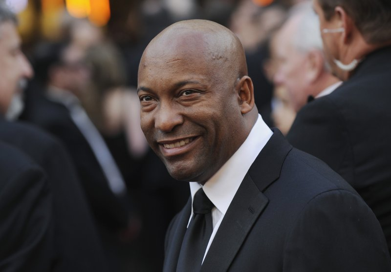 FILE - In this Feb. 24, 2008 file photo, director John Singleton arrives at the 80th Academy Awards in Los Angeles. (AP Photo/Chris Pizzello, File)