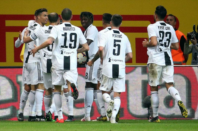 Juventus' Cristiano Ronaldo, left, celebrates with his teammates after scoring his side's first goal during the Serie A soccer match between Inter Milan and Juventus at the San Siro Stadium, in Milan, Italy, Saturday, April 27, 2019. (Roberto Bregani/ANSA via AP)