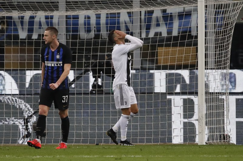 Juventus' Cristiano Ronaldo, center, reacts after failing a scoring chance during the Serie A soccer match between Inter Milan and Juventus at the San Siro Stadium, in Milan, Italy, Saturday, April 27, 2019. (AP Photo/Antonio Calanni)