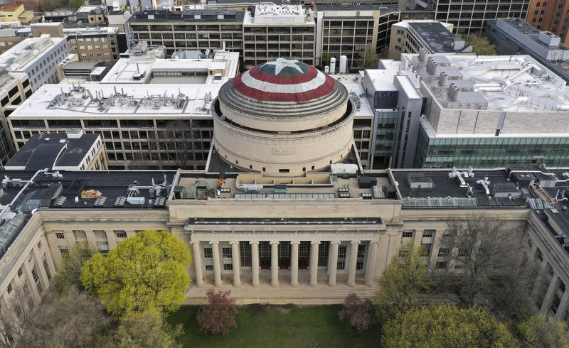 This Sunday, April 28, 2019 photo provided by Raymond Huffman shows Massachusetts Institute of Technology's signature Great Dome draped with a giant cloth version of Captain America's red, white and blue shield, in Cambridge, Mass. (Raymond Huffman via AP)