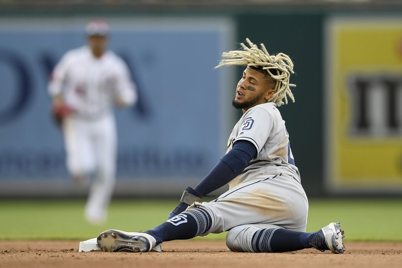 San Diego Padres' Fernando Tatis Jr. reacts after he stole second base during the fourth inning of a baseball game against the Washington Nationals, Sunday, April 28, 2019, in Washington. (AP Photo/Nick Wass)