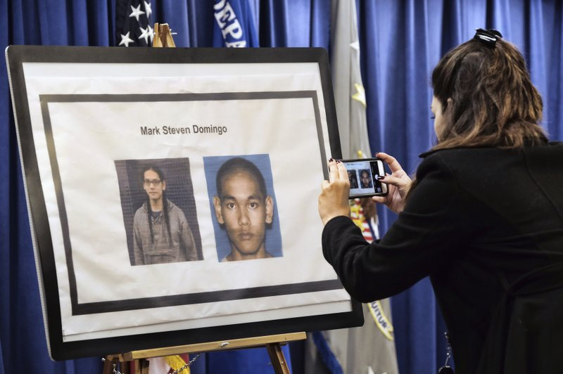 A reporter takes a photo of Mark Domingo, 26, from Reseda, Calif., displayed at a news conference in Los Angeles on Monday, April 29, 2019. ( AP Photo/Richard Vogel)