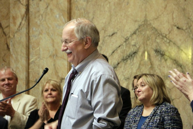 House Speaker Frank Chopp smiles following passage of a resolution honoring him, Sunday, April 28, 2019, in Olympia, Wash. (AP Photo/Rachel La Corte)