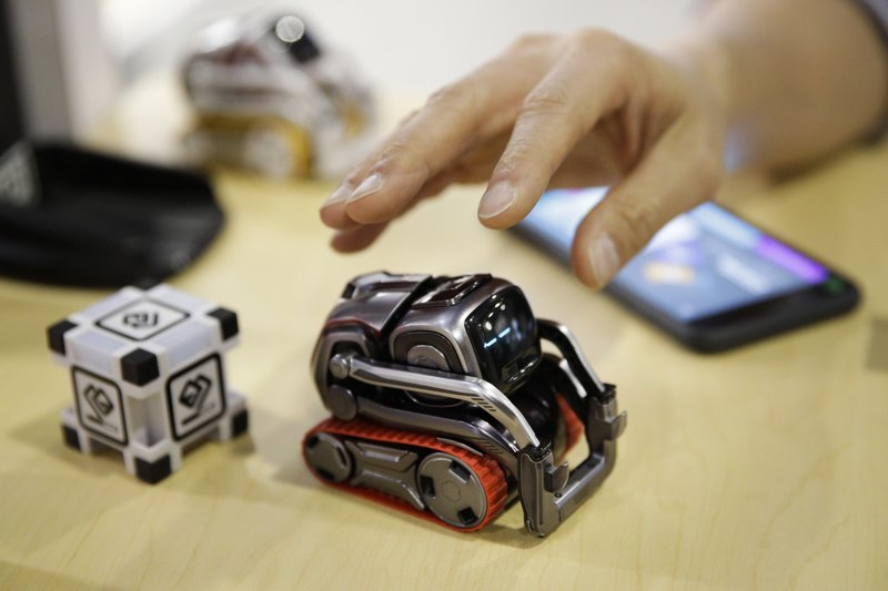FILE- In this Jan. 10, 2018, file photo, Anki Cozmo coding robot is on display at CES International in Las Vegas. A startup that tried to advance the dream of intelligent robots in the home with its toy robot Cozmo is shutting down. San Francisco-based Anki says it's laying off its employees on Wednesday, May 1, 2019 after failing to raise enough money to keep the business going. It's one of several high-profile makers of consumer robots to fold in the past year. (AP Photo/Jae C. Hong, File)