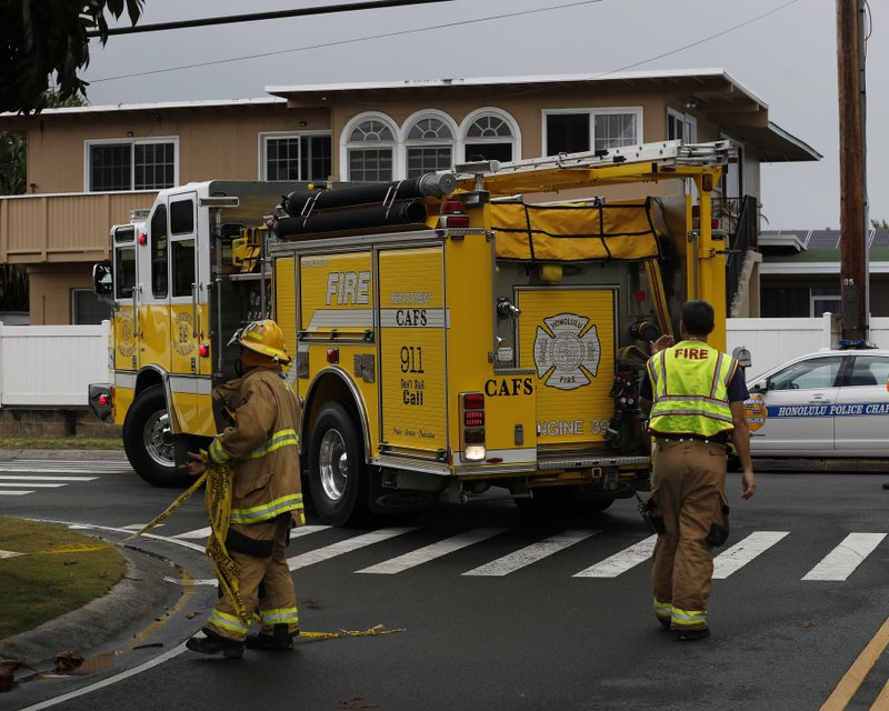 A fire truck blocks the street where a helicopter crashed, Monday, April 29, 2019, in Kailua, Hawaii. (AP Photo/Marco Garcia)