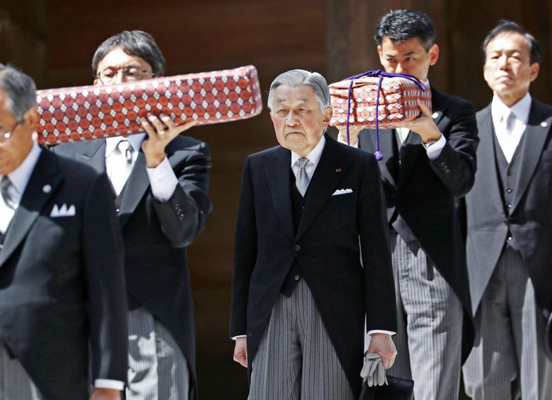 FILE - In this April 18, 2019, photo, Japanese Emperor Akihito, center, visits Ise Grand Shrine, or Ise Jingu, in Ise, central Japan. (Kyodo News via AP)