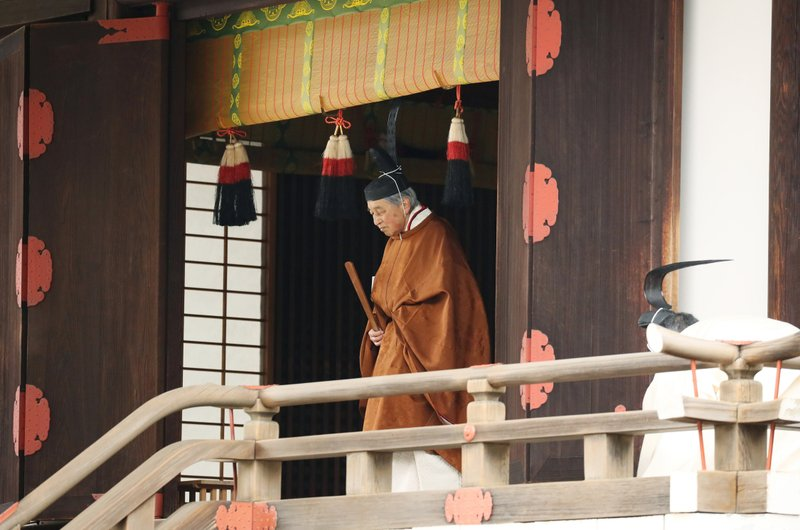 Japan's Emperor Akihito leaves after a ritual to report his abdication to the throne, at the Imperial Palace in Tokyo, Tuesday, April 30, 2019. (Japan Pool via AP)