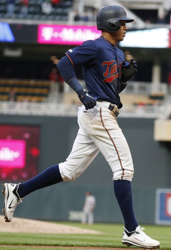 Minnesota Twins' Ehire Adrianza jogs home on a solo home run off Houston Astros pitcher Justin Verlander in the third inning of a baseball game Monday, April 29, 2019, in Minneapolis. (AP Photo/Jim Mone)