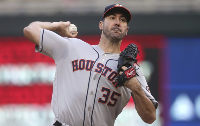 Houston Astros pitcher Justin Verlander throws against the Minnesota Twins in the first inning of a baseball game Monday, April 29, 2019, in Minneapolis. (AP Photo/Jim Mone)
